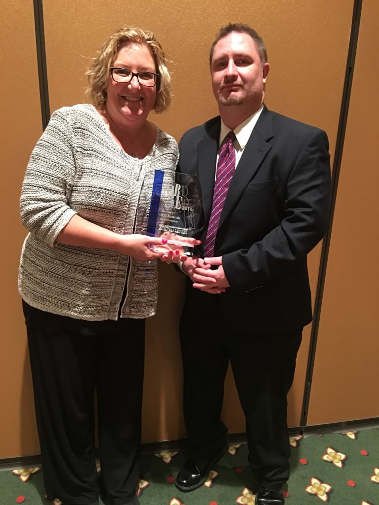 Kathryn & Larry with the AABE Award